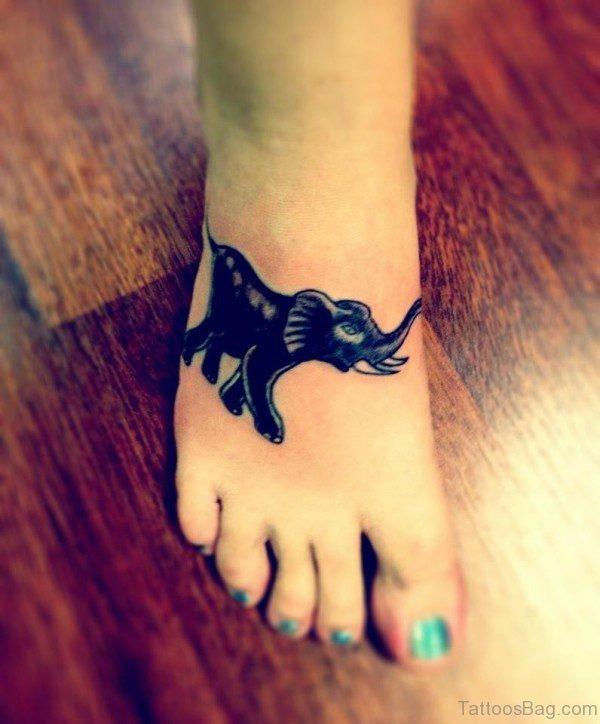 Black Ink Elephant Tattoo On Foot