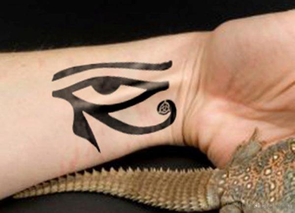 Black Ink Eye Tattoo On Wrist