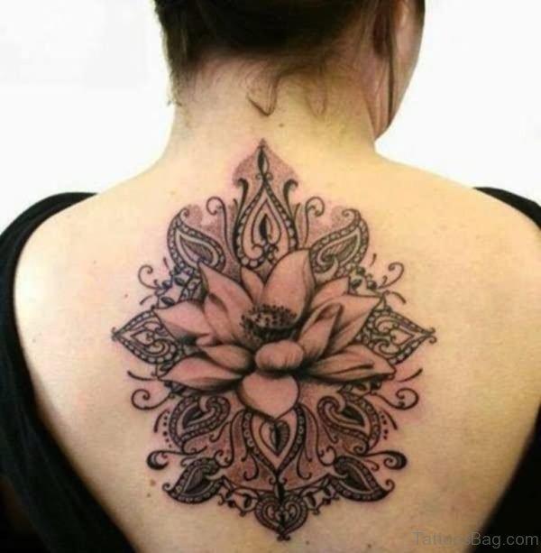 Black Ink Hippie Flower Tattoo On Upper Back
