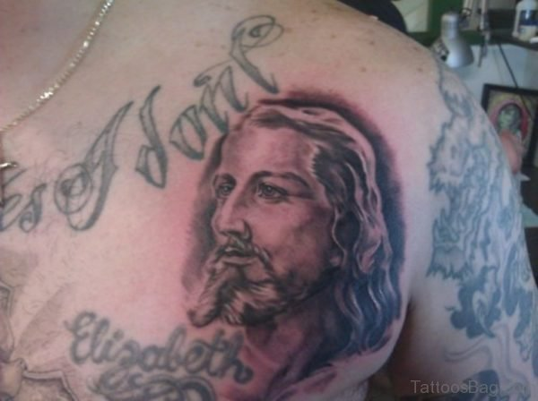 Black Ink Jesus Portrait Tattoo On Chest