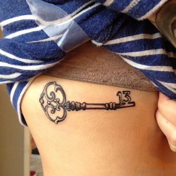 Black Ink Key Tattoo Design For Side Rib