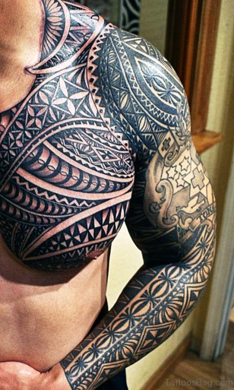 Black Ink Tattoo On Chest And Full Arm