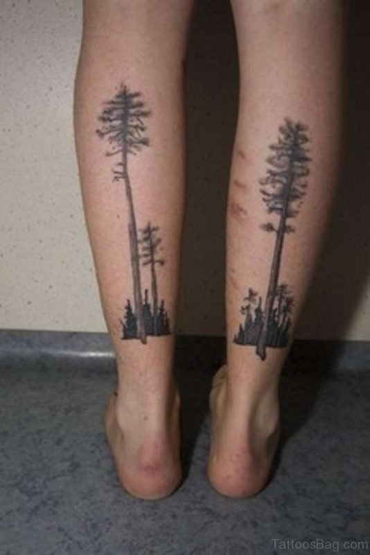 Black Ink Tree Tattoo On Both Leg Calf