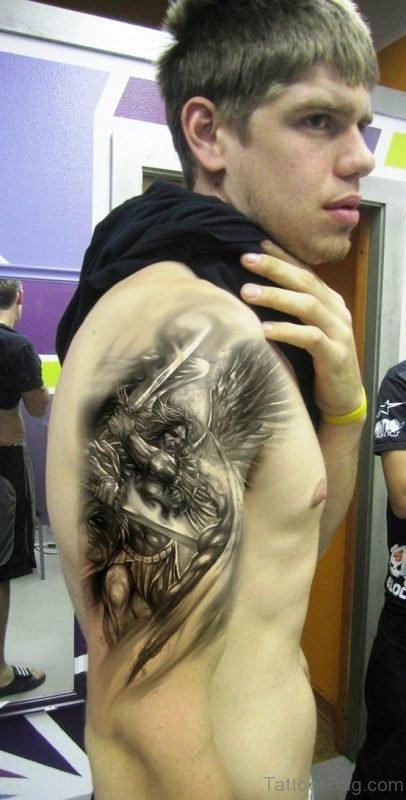 Black Inked Archangel Tattoo On Shoulder