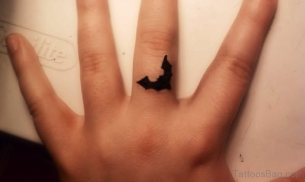 Black Inked Bat Tattoo On Finger