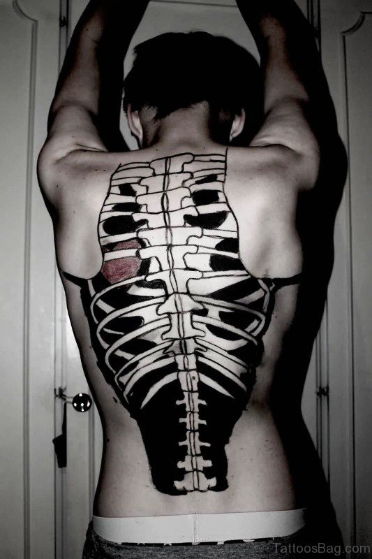 Black Inked Skeleton Tattoo On Back