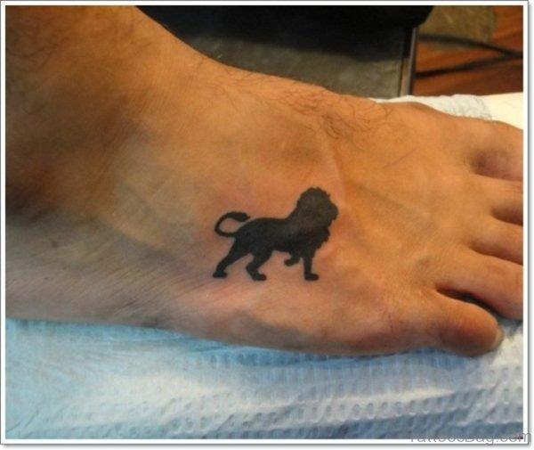 Black Lion Tattoo On Foot