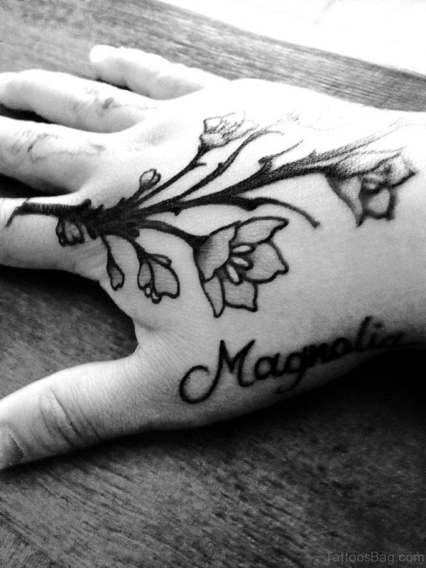 Black Magnolia Tattoo On Hand