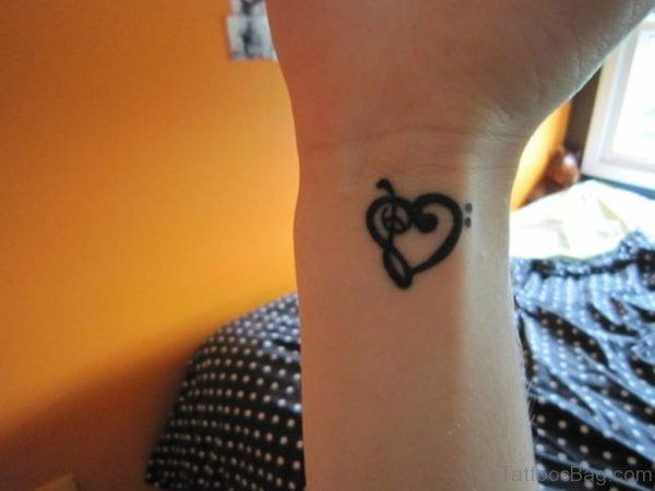 Black Music Note Tattoo On Wrist