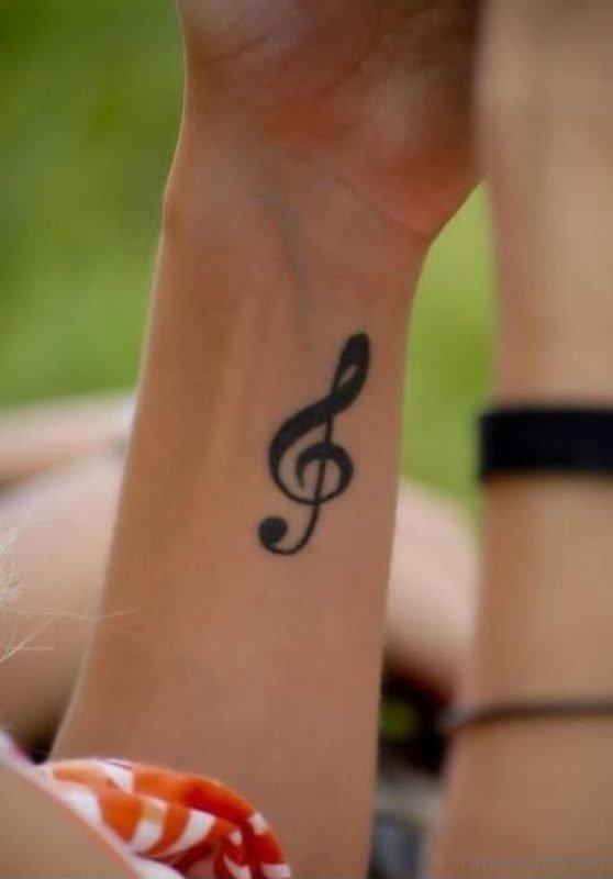 Black Music Word Tattoo On Wrist