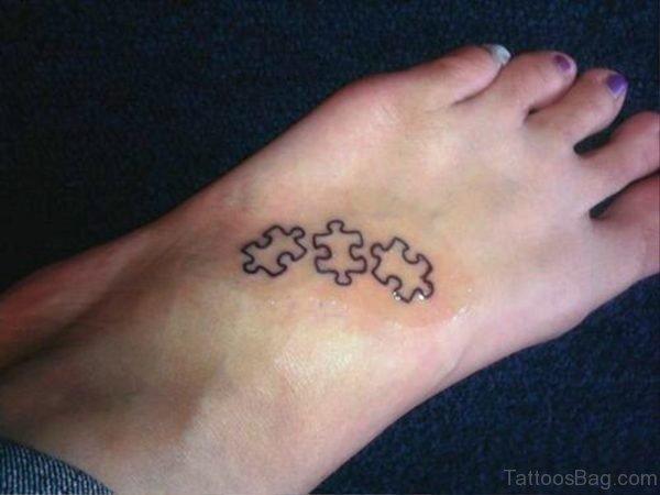 Black Outline Autism Tattoo On Foot