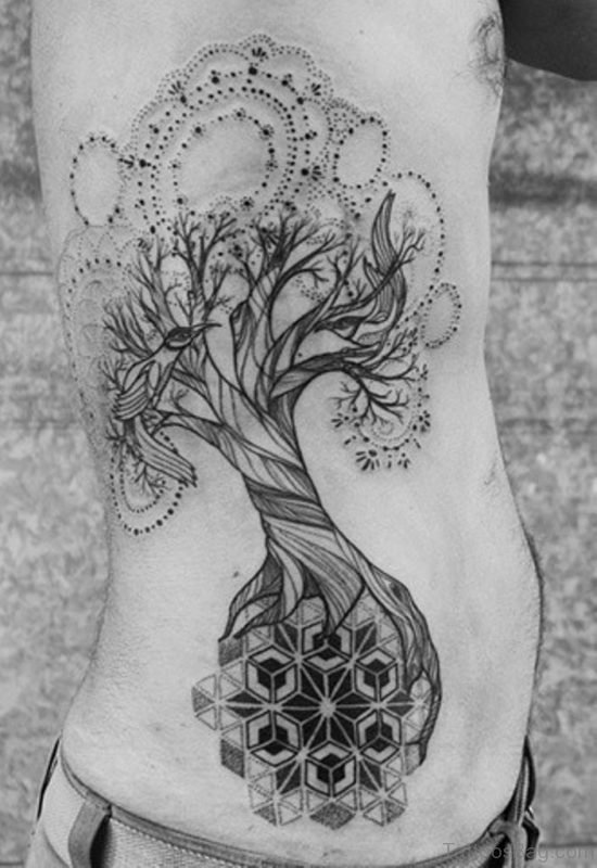 Black Patchwork Tree Tattoo On Rib