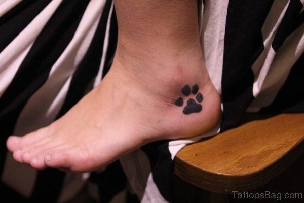 Black Paw Print Tattoo On Foot