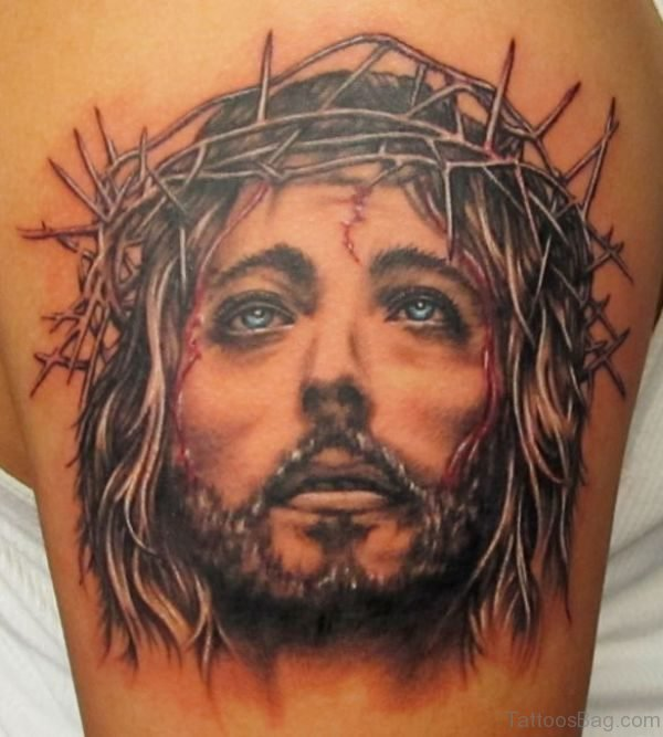 Black Religious Tattoo On Shoulder