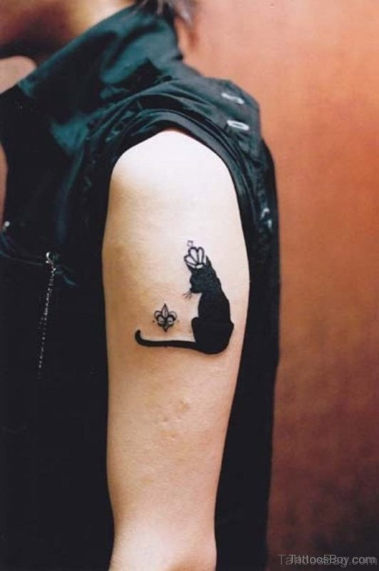 Black Sitting Cat Tattoo On Shoulder