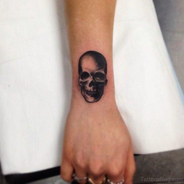 Black Skull Tattoo On Wrist