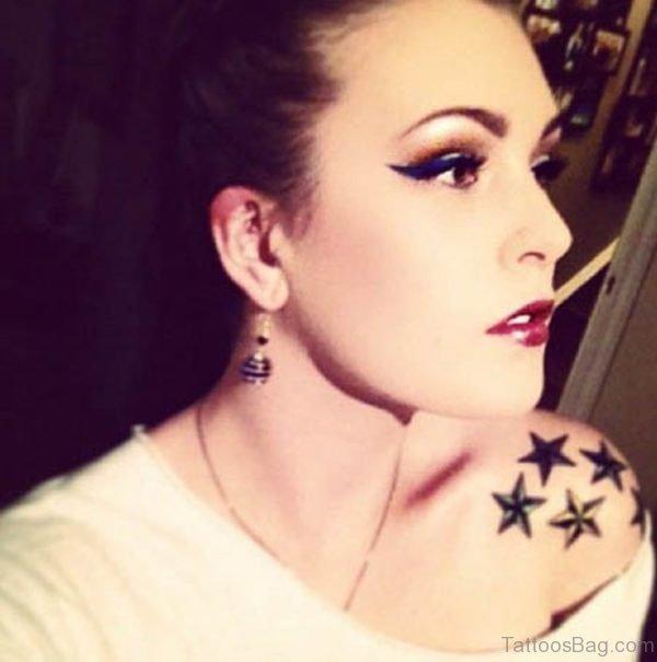 Black Star Shoulder Tattoo