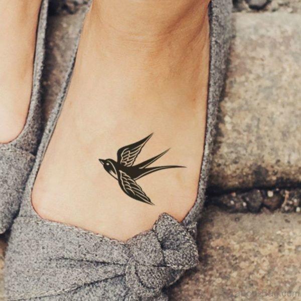 Black Swallow Tattoo On Foot