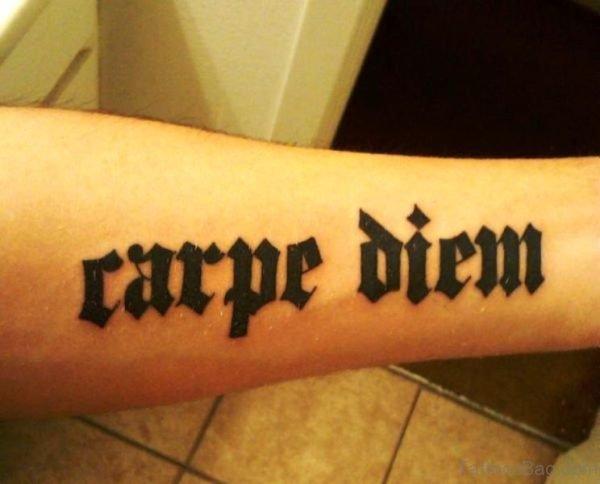 Black Thick Carpe Diem Tattoo On Arm