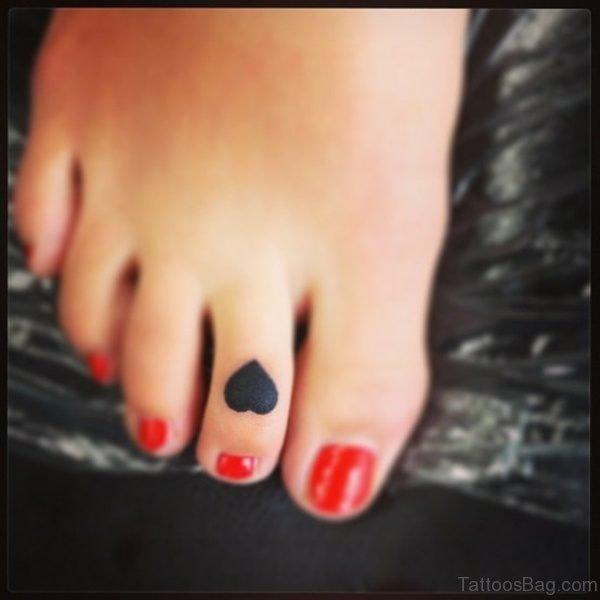 Black Tiny Heart Tattoo