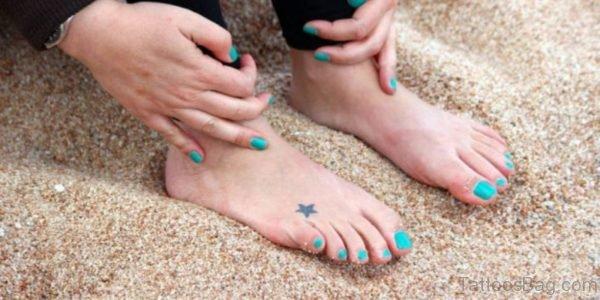 Black Tiny STar Tattoo
