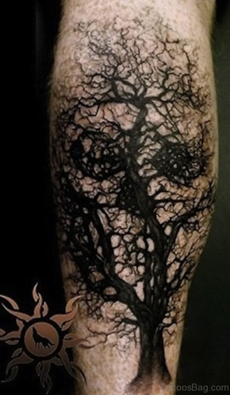 Black Tree Without Leaves With Skull Tattoo On Leg