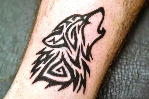 Black Tribal Alpha Wolf Tattoo On Arm