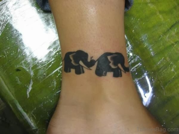 Black Two Elephant Tattoo On Leg