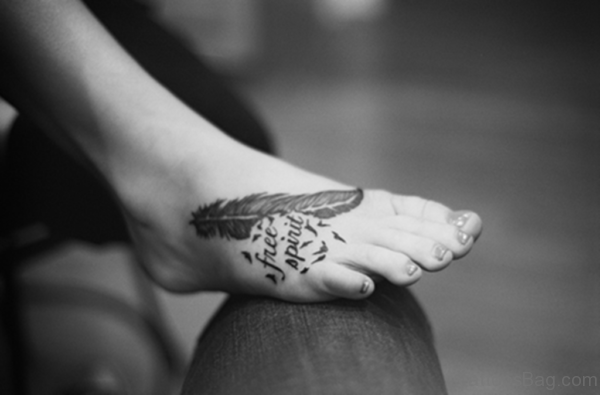 Black Word And Feather Tattoo