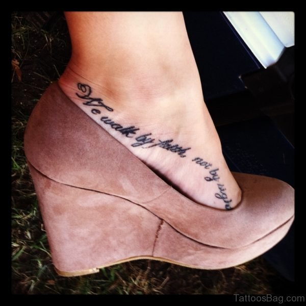 Black Wording Tattoo On Foot