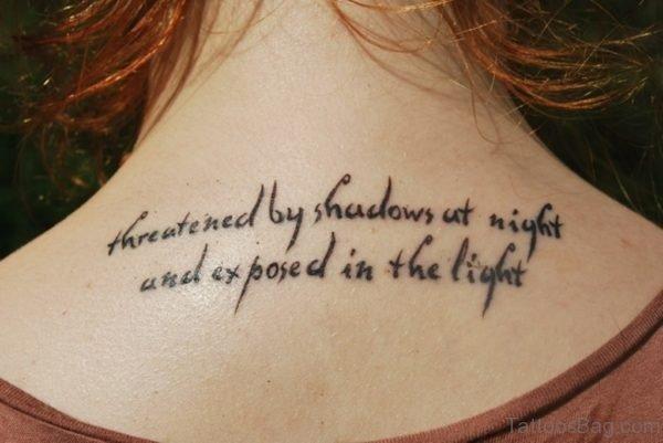 Black Wording Tattoo On Upper Back
