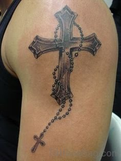 Black and grey cross with rosary tattoo on half sleeve