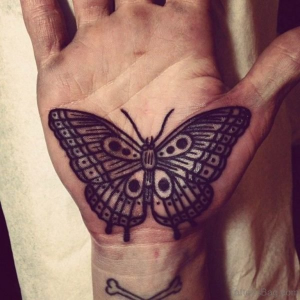Black ink outline butterfly tattoo