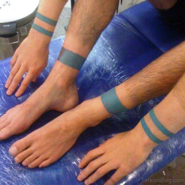 Blue Band Tattoo On Legs And Arms