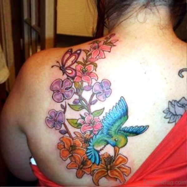 Blue Bird With Colorful Flowers Tattoo