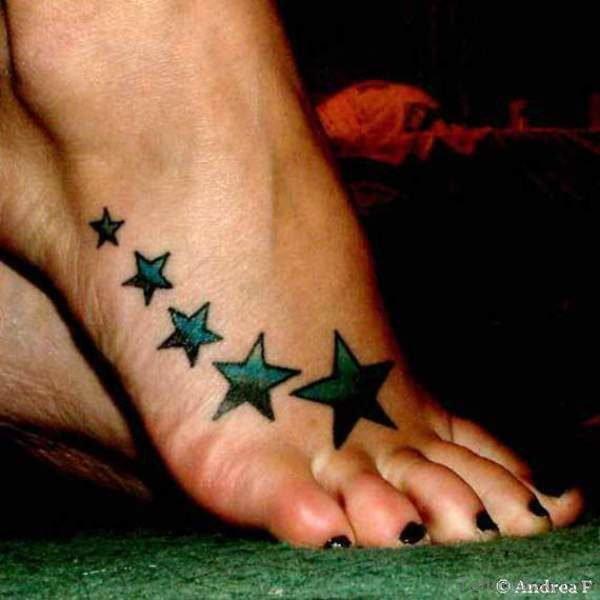 Blue Black Stars Tattoo On Foot