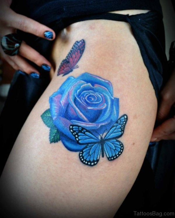 Blue Butterfly And Rose Tattoo On Thigh