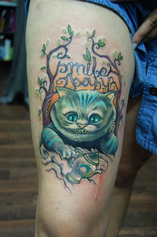 Blue Cheshire Cat Tattoo On Thigh