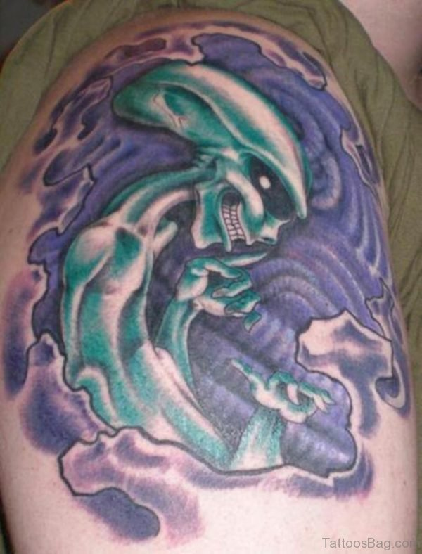 Blue Ink Alien Tattoo