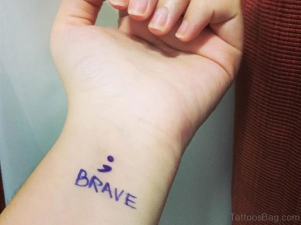 Blue Ink Brave Tattoo On Wrist