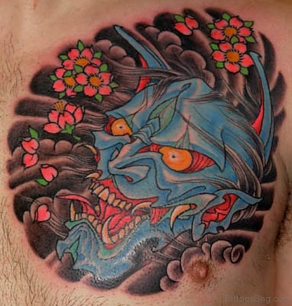 Blue Ink Hannya Tattoo On Man Chest