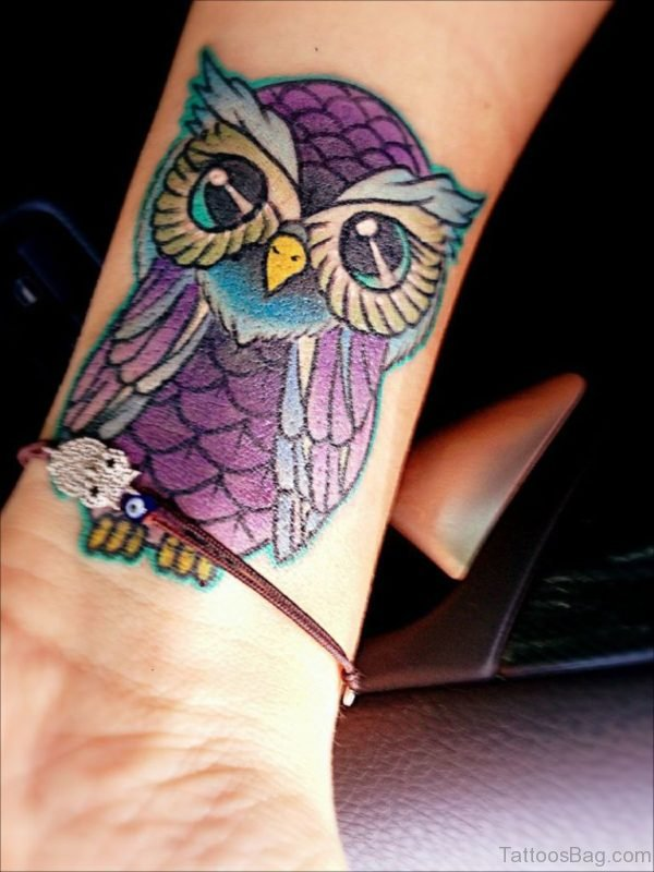 Blue Owl Tattoo On Wrist