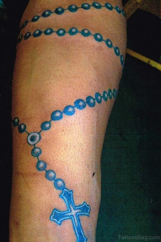 Blue Rosary Beads Tattoo On Arm