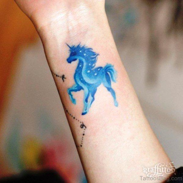 Blue Unicorn Tattoo On Wrist