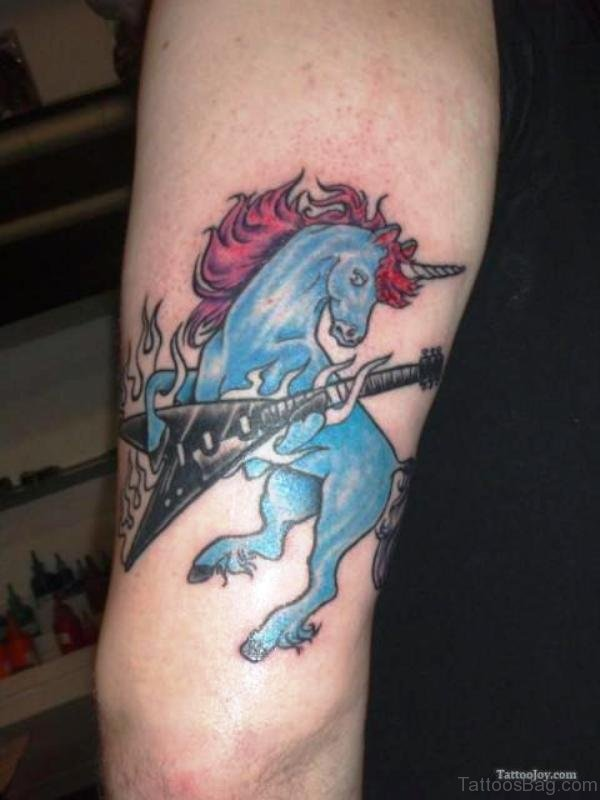 Blue Unicorn With Guitar Tattoo