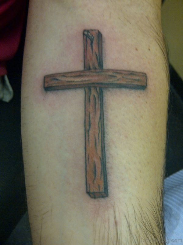Brown Cross Tattoo On Arm