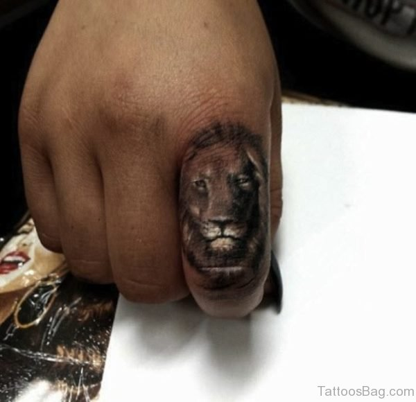 Brown Lion Tattoo On Finger