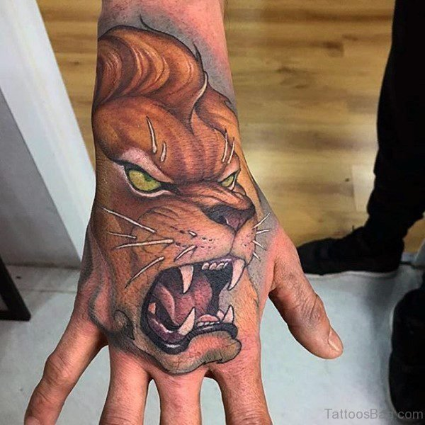 Brown Roaring Lion Tattoo On Hand