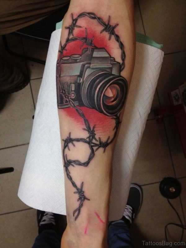 Camera And Barbed Wire Tattoo On Arm