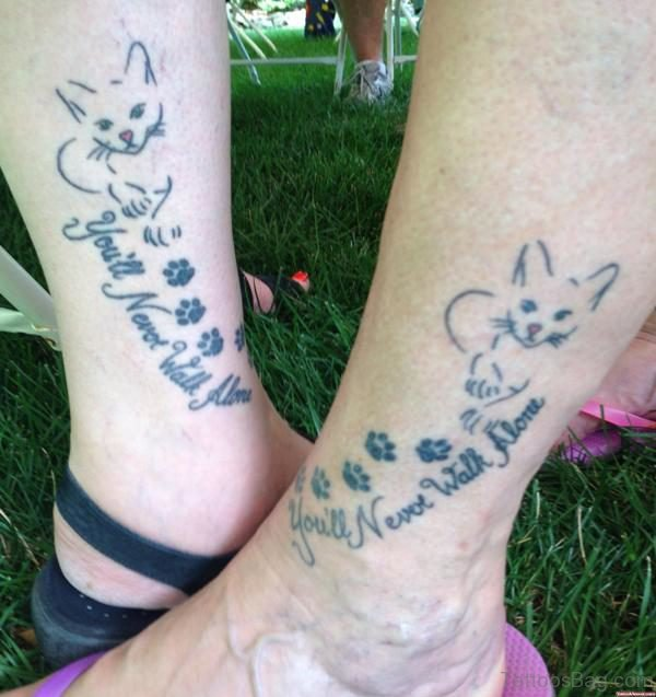 Cat And Lettering Tattoo On Leg